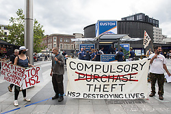 """Stop HS2 campaigners take part in outreach activities directly in front of a HS2 Routewide Roadshow at Kings Cross Square on 5th August 2021 in London, United Kingdom. There have been increasing doubts regarding the viability of the northern section of the HS2 high-speed rail link since a recent report published by the Infrastructure and Projects Authority gave Phase 2b the lowest 'red' rating, indicating that successful delivery of the scheme """"appears to be unachievable""""."""