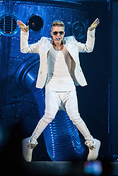 "© Licensed to London News Pictures . FILE PICTURE DATED 21/02/2013 of Canadian pop star JUSTIN BIEBER performing on stage at the Manchester Arena , UK , on the opening night of his UK "" Believe "" tour , as a spokeswoman last night (7th March) reported Bieber had to take an unscheduled break during a show at the O2 Arena last night (7th March). Bieber was said to have fainted and had to be treated by doctors with oxygen before returning to the stage . Photo credit : Joel Goodman/LNP"