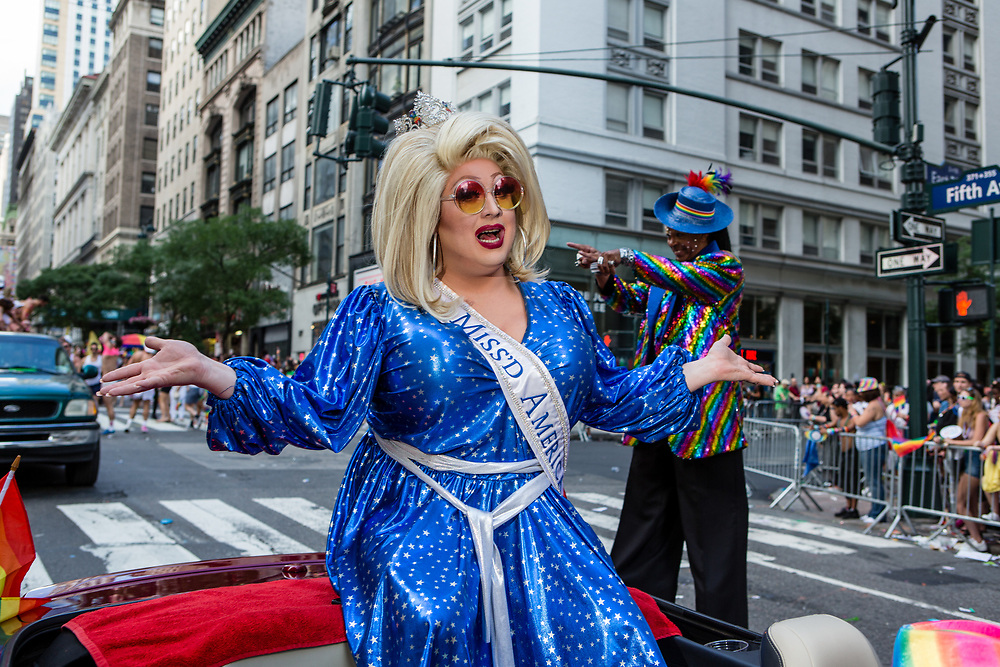 New York, NY - 25 June 2017. New York City Heritage of Pride March filled Fifth Avenue for hours with groups from the LGBT community and it's supporters. Miss'd America, drag queen Mimi Imfurst (Braden Chapman) rides in the march.