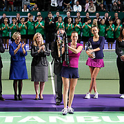 Petra Kvitova (F) of Czech Republic holds up the trophy after she won the final match against Victoria Azarenka of Belarus at the WTA Championships tennis tournament in Istanbul, Turkey on 30 October 2011. Photo by TURKPIX