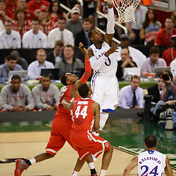 Mar 31, 2012; New Orleans, LA, USA; Kansas Jayhawks forward Thomas Robinson (0) goes up for a lay up as Ohio State Buckeyes forward Deshaun Thomas (left) and guard William Buford (44) defend during the first half in the semifinals of the 2012 NCAA men's basketball Final Four at the Mercedes-Benz Superdome. Mandatory Credit: Derick E. Hingle-US PRESSWIRE