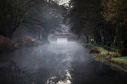© Licensed to London News Pictures. 02/01/2017. Godalming, UK. A cyclist makes his way along a tow path alongside the River Wey near Godalming at sunrise, on a cold winter morning. Photo credit: Peter Macdiarmid/LNP