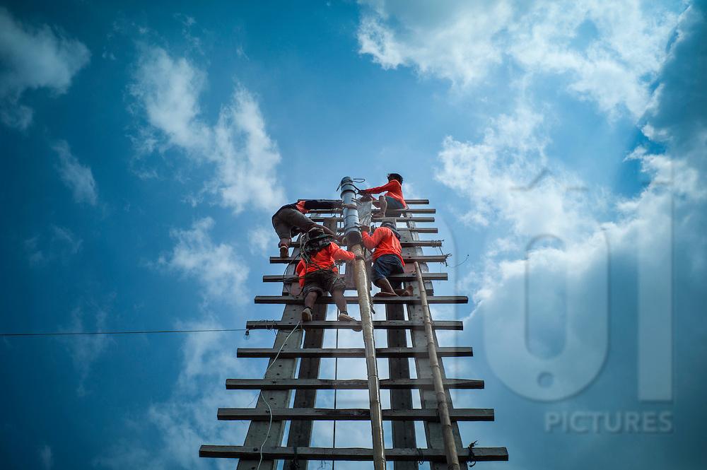 Contestants install their rocket on the launching ramp during Boun Bang Fai, aka Rocket Festival, Ban Don Nieng, a small village near Vientiane, Laos, Southeast Asia