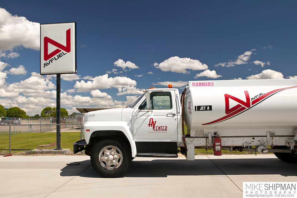 White fuel truck parked next to sign, Avfuel, AVCenter, Nampa, Idaho, USA