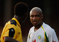 Picture: Henry Browne.<br /> Date: 17/08/2005.<br /> Senegal v Ghana International Friendly at Griffin Park, Brentford, London.<br /> El Hadj Diouf of Senegal gets angry with John Pantsil of Ghana after getting fouled.