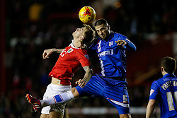 Aden Flint of Bristol City and Max Ehmer of Gillingham compete in the air - Photo mandatory by-line: Rogan Thomson/JMP - 07966 386802 - 29/01/2015 - SPORT - FOOTBALL - Bristol, England - Ashton Gate Stadium - Bristol City v Gillingham - Johnstone's Paint Trophy Southern Area Final Second Leg.