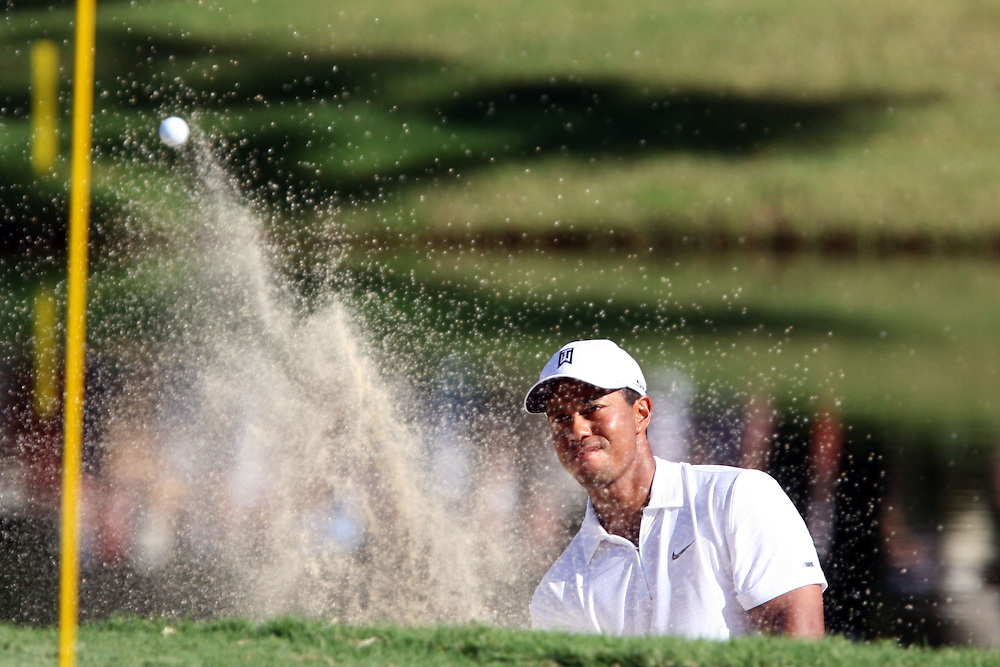 10 August 2007: Tiger Woods blasts out of the green-side bunker to score a birdie on the 13th hole during the second round of the 89th PGA Championship at Southern Hills Country Club in Tulsa, OK.