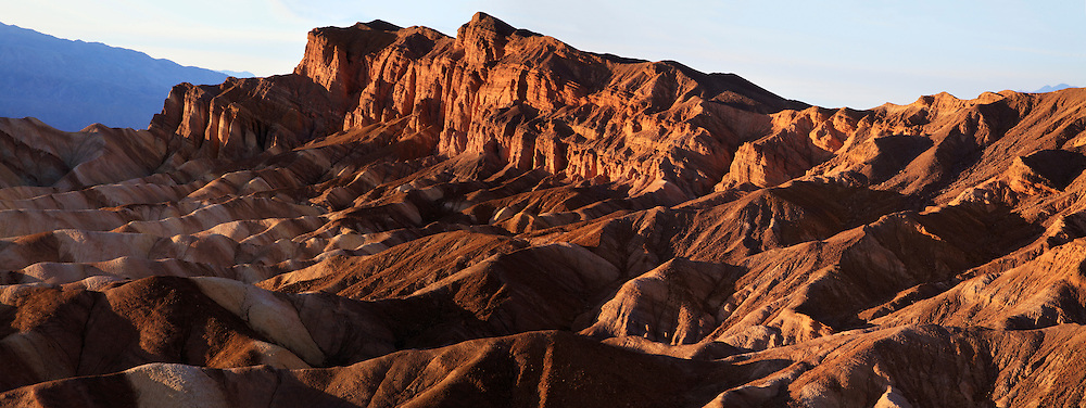Deeply Eroded And Shadowed Ridges As The Sun Sets Over Zabriskie Point, Death Valley National Park, California, USA