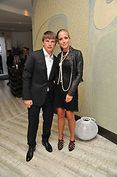 Footballer ANDREI ARSHAVIN and his wife YULIA at the second night of the Tomodachi (Friends) Charity Dinners hosted by Chef Nobu Matsuhisa in aid of the Japanese committee for UNICEF held at Nobu Berkeley, Berkeley Street, London on 5th May 2011.