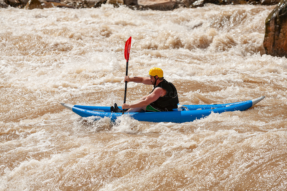 A paddler in an inflatable kayak enters a rapid in Cataract Canyon — a 46 mile long canyon of the Colorado River located within Canyonlands National Park and Glen Canyon National Recreation Area in southern Utah. Photo © Robert Zaleski / rzcreative.com<br /> —<br /> To license this image for editorial or commercial use, please contact Robert@rzcreative.com