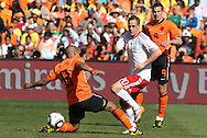 14 JUN 2010: Thomas Enevoldsen (DEN) (20) slips the ball under Nigel de Jong (NED) (8). The Netherlands National Team defeated the Denmark National Team 2-0 at Soccer City Stadium in Johannesburg, South Africa in a 2010 FIFA World Cup Group E match.