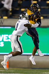 California wide receiver Kekoa Crawford (11) leaves his feet to catch a pass in front of Nevada defensive back Berdale Robins (0) during the third quarter of an NCAA college football game, Saturday, Sept. 4, 2021, in Berkeley, Calif. (AP Photo/D. Ross Cameron)