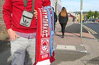 A scarf seller holds his goods outside Turf Moor<br /> <br /> Photographer Alex Dodd/CameraSport<br /> <br /> UEFA Europa League - UEFA Europa League Qualifying Second Leg 2 - Burnley v Olympiakos - Thursday August 30th 2018 - Turf Moor - Burnley<br />  <br /> World Copyright © 2018 CameraSport. All rights reserved. 43 Linden Ave. Countesthorpe. Leicester. England. LE8 5PG - Tel: +44 (0) 116 277 4147 - admin@camerasport.com - www.camerasport.com