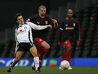 Photo: Lee Earle.<br /> Fulham v Stoke City. The FA Cup. 27/01/2007.Fulham's Vincenzo Montella (L) battles with Dominic Matteo.