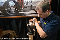 Hand engraving demonstration in the Abnormal Cycles booth during Motor Bike Expo. Verona, Italy. January 23, 2016.  Photography ©2016 Michael Lichter.