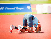 MUTAZ ESSA BARSHIM (QAT) kisses the ground as the 21-year-old Olympic bronze medalist in the high jump cleared a bar at 7 feet, 10 1/2 inches. He became just the eighth man in history to go that high and the first to do it in 13 years.<br /> Barshim declined to go after the world record of eight feet even, but he earned the Prefontaine Classic's Maria Mutola Award as athlete of the meet . This was the second day of the Diamond League event Prefontaine Classic held at the University of Oregons Hayward Field.The Prefontaine Classic is named for University of Oregon track legend Steve Prefontaine.