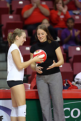 31 OCT 2008:  Erin Lindsey receives a commemorative ball from coach Melissa Myers for a career milestone prior to a match in which the Missouri State Bears defeated the Redbirds of Illinois State 3 sets to 2 on Doug Collins Court inside Redbird Arena in Normal Illinois