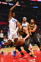 January 28, 2019 - Los Angeles, CA, U.S. - LOS ANGELES, CA - JANUARY 28: Atlanta Hawks Guard Jeremy Lin (7) drives to the basket being defended by Los Angeles Clippers Guard Shai Gilgeous-Alexander (2) during a NBA game between the Atlanta Hawks and the Los Angeles Clippers on January 28, 2019 at STAPLES Center in Los Angeles, CA. (Photo by Brian Rothmuller/Icon Sportswire) (Credit Image: © Brian Rothmuller/Icon SMI via ZUMA Press)