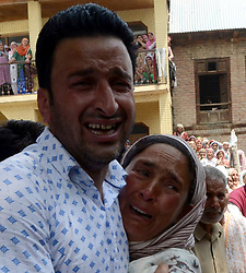 June 17, 2017 - Budgam, Jammu and Kashmir, India - People offering Nimaza Jinaza of slain constable Tasveer Ahmad Dar in his native village Sorasyar area of Budgam District.who was killed in a militant attack along with Five other Cops in Achabal area of south Kashmir. (Credit Image: © Aasif Shafi/Pacific Press via ZUMA Wire)