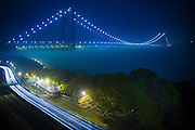 The George Washington Bridge shrouded in fog as traffic flows up the Henry Hudson Parkway.  The George Washington Bridge, connecting New York City to Bergen County, NJ, is the worlds busiest suspension bridge.