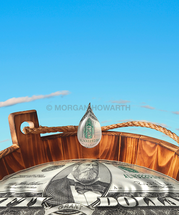 water droplet falling into wooden bucket of water with fifty dollar bill reflected in surface of water