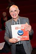 Presentatie van Het Grote Koffietafelboek - 20 Jaar Top 2000 in Beeld en Geluid, Hilversum.<br /> <br /> op de foto:  Frits Spits met het boek 20 jaar top 2000