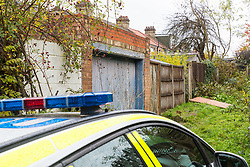 Police guard the back alley behind the Evesham Road home of 98 year-old pensioner XXX who was attacked in his home and is now fighting for his life in hospital. London, November 07 2018.