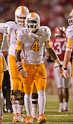 Nov 12, 2011; Fayetteville, AR, USA;  Tennessee Volunteers tailback Marlin Lane (4) stands on the field during a time out in a game against the Arkansas Razorbacks at Donald W. Reynolds Razorback Stadium. Arkansas defeated Tennessee 49-7. Mandatory Credit: Beth Hall-US PRESSWIRE