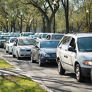 Two lanes of cars are stuck in heavy traffic in Washington DC.