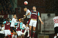 Andy Carroll of West Ham United heads the ball over Marcos Rojo of Manchester United. The Emirates FA cup, 6th round replay match, West Ham Utd v Manchester Utd at the Boleyn Ground, Upton Park  in London on Wednesday 13th April 2016.<br /> pic by John Patrick Fletcher, Andrew Orchard sports photography.