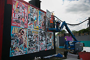 Art work going up at Shangri-la at the Glastonbury Festival 21th July 2016, Somerset, United Kingdom. Shangri-la is a venue at the festival with  art and politics mixed with tunes and all night club nights. Work getting the festival ready takes weeks and in the days up to the festival starts work is frantic.  The Glastonbury Festival runs over 3 days and has 3000 acts, including music, art and performance and approx. 150.000 attend the anual event.