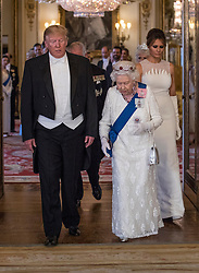 US President Donald Trump and Queen Elizabeth II arrive for a group photo ahead of the State Banquet at Buckingham Palace, London, on day one of US President Donald Trump's three day state visit to the UK.