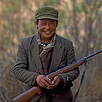 CHINA, TIBET, Tsangpo Gorge. A hunter (poacher) from Kykar village who augments his income & larder shooting takin, musk deer & other wildlife.