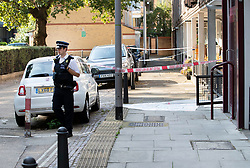 © Licensed to London News Pictures. 13/08/2019. London, UK. A police officer guards the crime scene in Munster Square Camden where a male was stabbed to death last night. The victim, whose age has not yet been released, was pronounced dead at the scene after police were called shortly after 11pm. Photo credit: Peter Macdiarmid/LNP