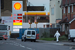 © licensed to London News Pictures. London, UK 03/11/2012. Forensic officers investigating a crime scene on the forecourt of a Shell petrol station in Ley Street, Ilford as a 29-year-old man, suffering stab wounds, was pronounced dead at the scene. Photo credit: Tolga Akmen/LNP