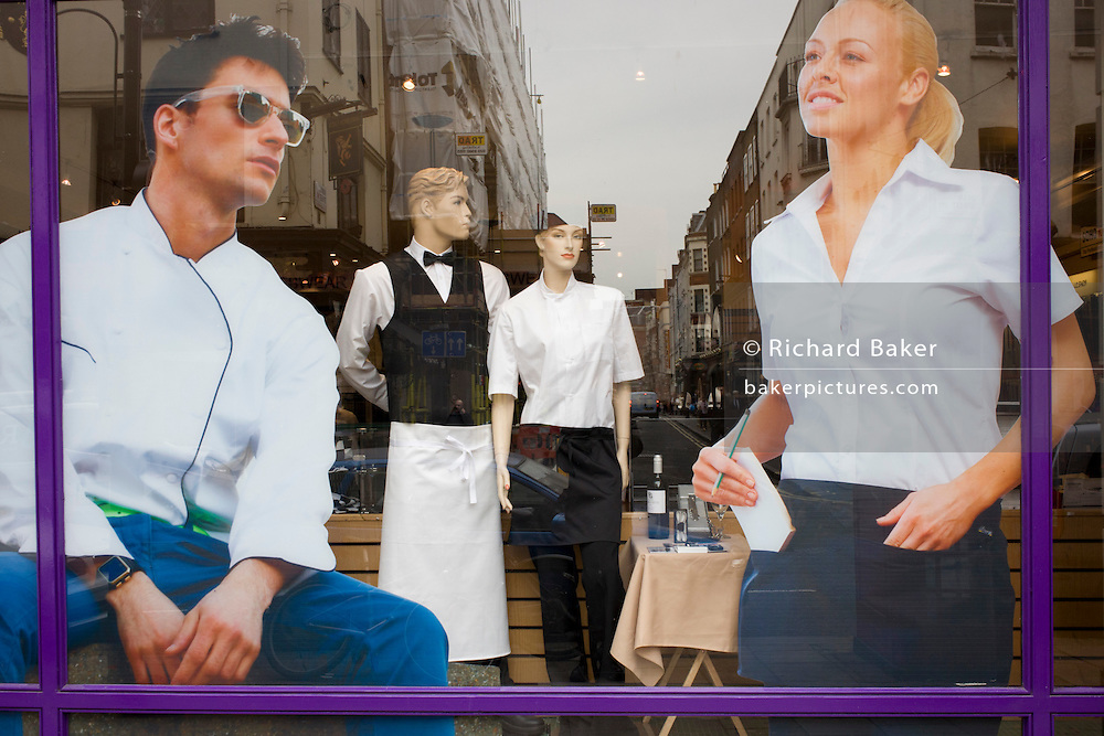 Stylish mannequins and illustrations of staff wearing uniforms in a Soho street.