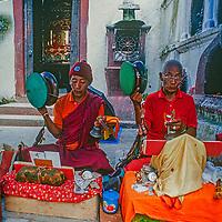 Tibetran Buddhist musicians perform outside a temple in Kathmandu, Nepal, 1996.