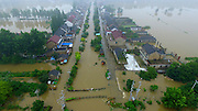 YANGZHOU, CHINA - JULY 06: <br /> <br /> Aerial view of villages and roads in Yizhengxinji Town being flooded as a dyke bursts due to heavy rainstorm on July 6, 2016 in Yangzhou, Jiangsu Province of China. Heavy rainstorm continued in southern China which affected local residents\' whole way of life. <br /> ©Exclusivepix Media