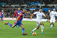 Andros Townsend of Crystal Palace closed down by Neil Taylor of Swansea City during the Premier League match between Swansea City and Crystal Palace at the Liberty Stadium, Swansea, Wales on 26 November 2016. Photo by Andrew Lewis.