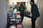Workers and volunteers at Hackney Foodbank receive and organize food donations, 15th of December 2021, Hackney, East London, United Kingdom. The Hackney Food Bank is part of a nationwide network of foodbanks, supported by The Trussell Trust, working to combat poverty and hunger across the UK. The food bank gives out three days emergency food supplies to families and individual who go hungry in the borrough. The food is all donated by individuals and the food donated is held in a small ware house where it is  sorted and packed for distribution.  More people than ever in Britain have turned to the food bank for help and in Hackney the need has gone up with 350% over the past two years.
