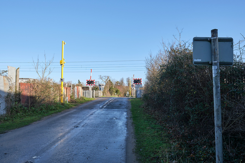 Looking towards the level crossing, Great Eastern Main Line in Baylham. Mill Lane leads to the Baylham Rare Breeds Center. Network Rail have installed safety enforcement cameras on the crossing which has half barriers. <br /> <br /> Photo by Jonathan J Fussell, COPYRIGHT 2020
