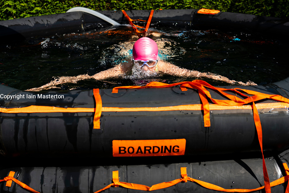 Uphall, Scotland, UK. 25 May 2020. Emily Aston, a wild open water swimmer with the Fife Wild Swimmers group, during a daily dip in her garden pool made from a ship's liferaft.  Many wild swimmers have been denied the opportunity to pursue their sport during Covid-19 lockdown and have purchased pools for their gardens to maintain their wellbeing. Iain Masterton/Alamy Live News