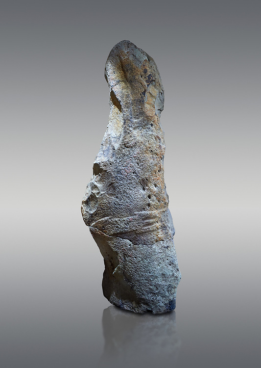 Late European Neolithic prehistoric Menhir standing stone with carvings on its face side. The remains of a representation of a stylalised male figure starts at the top with a long nose from which 2 eyebrows arch around the top of the stone. below this is a carving of a falling figure with head at the bottom and 2 curved arms encircling a body above. at the bottom is a carving of a dagger running horizontally across the menhir. the bottom is a carving of a dagger running horizontally across the menhir. Excavated from Piscina 'E Sali IV site,  Laconi.  Menhir Museum, Museo della Statuaria Prehistorica in Sardegna, Museum of Prehoistoric Sardinian Statues, Palazzo Aymerich, Laconi, Sardinia, Italy. Grey background. .<br /> <br /> Visit our PREHISTORIC PLACES PHOTO COLLECTIONS for more photos to download or buy as prints https://funkystock.photoshelter.com/gallery-collection/Prehistoric-Neolithic-Sites-Art-Artefacts-Pictures-Photos/C0000tfxw63zrUT4
