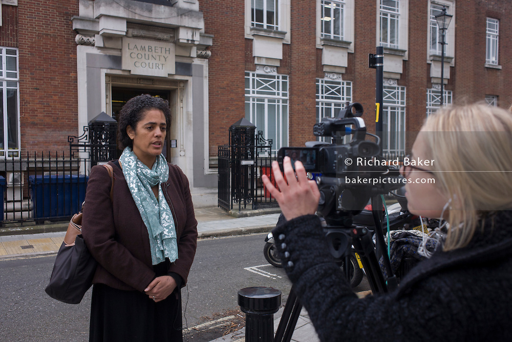 Campaigner Sara Bredemear is interviewed after her courst appearence outside Lambeth County Court in Kennington after the hearing to fight occupation of Carnegie Library in Herne Hill, south London while occupiers remain inside the premises on day 9 of its occupation, 8th April 2016. The angry local community in the south London borough have occupied their important resource for learning and social hub for the weekend. After a long campaign by locals, Lambeth have gone ahead and closed the library's doors for the last time because they say, cuts to their budget mean millions must be saved.