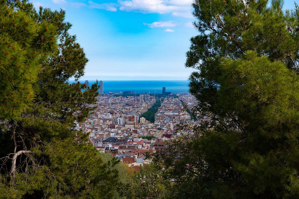 View of Barcelona skyline from Parc Guell, Barcelona, Catalonia, Spain. A public park design by famed Catalan architect Antoni Gaudi featuring gardens and architectural curiosities.