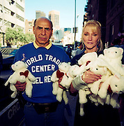 During a journey into America's hinterlands, days after the September 11th attacks in New York and Washington DC, eccentric New Yorkers gather at the city's Armory to offer help and support by handing our fluffy bunnies to passers-by. The streets between 66th and 67th Streets, in the heart of Manhattan's Upper East Side, DNA samples were taken at the Armory so human remains might be identified. It was therefore a point of focus for those with missing relatives who attached thousands of posters to walls with pictures and messages to loved-ones in the hope of being reunited. Emotions were running high and many citizens offered spiritual aide such as food and drink. In outpourings of grief, anger and patriotic rhetoric, flags were flown as never before as  America sought to express their emotions and unity..