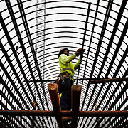 A construction worker with Border Rebar LLC, Reinforcing steel, Post Tension & SIP Specialist, of Gastonia, NC, places a hundred foot long bar of rebar inside a drill shaft before it will be secured and reinforced with concrete as a column for part of the bridge in the Bluffton Parkway flyover construction along Fording Island Road (278) on February 9, 2015.