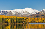 Reflection of autumn colors on Clunie Lake in Southcentral Alaska. Afternoon.