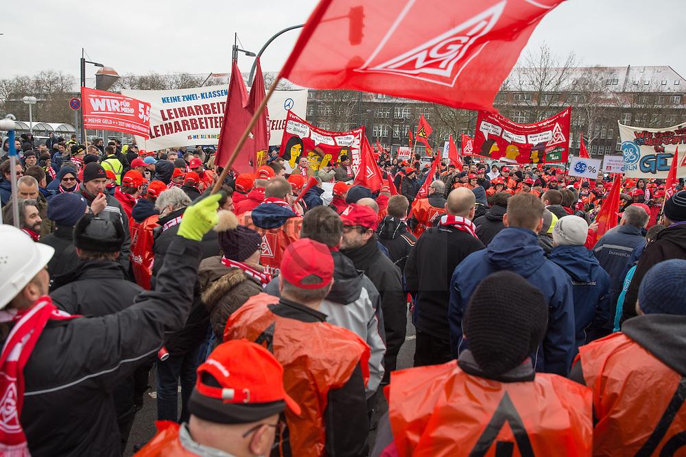 Berlin, Germany -  04.02.2015 <br /> <br /> IG Metall strike rally outside of Mercedes-Benz in Berlin-Marienfeld. Employees of the morning shift of several near by concerns lay down tools and join they rally. The union IG Metall demands in the current Germany-wide wage negotiations in the metal industry, among others 5.5% rise in wages.<br /> <br /> IG-Metall Warnstreik Kundgebung vor dem Mercedes-Benz Werk in Berlin-Marienfelde. Beschaeftigte der Frühschicht verschiedener umliegender Unternehmen legen die Arbeit nieder und beteiligen sich an der Streik-Kundgebung. Die Gewerkschaft IG-Metall fordert in der aktuellen deutschlandweiten Tarifauseinandersetzung in der Metall-Branche u.a. 5,5% mehr Lohn.  <br /> <br /> Photo: Bjoern Kietzmann