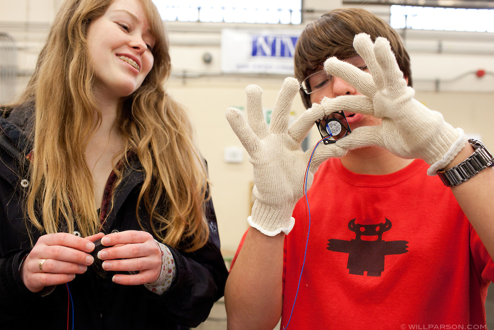 La Jolla High School students Julia Haerr and Luke Vickrey test out a fan that came with the box of parts their team will use in the FIRST Robotics Competition.